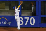 New York Mets' Michael Conforto catches a fly ball by Baltimore Orioles' Rio Ruiz during the sixth inning of a baseball game Wednesday, Sept. 9, 2020, in New York. (AP Photo/Kathy Willens)