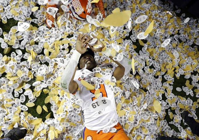 The Latest: Clemson returns home to thousands of fans