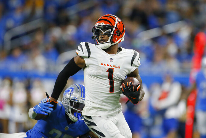 Cincinnati Bengals wide receiver Ja'Marr Chase (1) is tackled by Detroit Lions cornerback Jerry Jacobs during the second half of an NFL football game, Sunday, Oct. 17, 2021, in Detroit. (AP Photo/Duane Burleson)