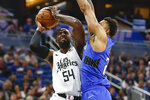 Orlando Magic center Khem Birch, right, blocks a shot by Los Angeles Clippers forward Patrick Patterson (54) during the first quarter of an NBA basketball game in Orlando, Fla., Sunday, Jan. 26, 2020. (AP Photo/Reinhold Matay)