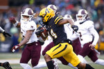 Appalachian State wide receiver Malik Williams (14) runs the ball during the first half of an NCAA college football game against Texas State Saturday, Nov. 23, 2019, in Boone, N.C. (AP Photo/Brian Blanco)