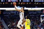 New Orleans Pelicans center Jaxson Hayes (10) reaches for the ball over Golden State Warriors forward Glenn Robinson III (22) in the first half of an NBA basketball game in New Orleans, Sunday, Nov. 17, 2019. (AP Photo/Tyler Kaufman)