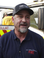 In this Jan. 10, 2020, photo, American firefighter Bill King arrives at a staging area at Candelo, Australia, before moving on to the fire brigade at Burragate. It seemed imminent to those hunkering at the fire station that
