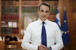 In this photo provided by the Greek Prime Minister's Office, Greece's Prime Minister Kyriakos Mitsotakis addresses the Greek nation on State TV in Athens, Wednesday, May 20, 2020. Greece's government detailed guidelines on how the summer tourist season will be operate. (Dimitris Papamitsos/Greek Prime Minister's Office via AP)