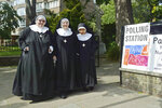 From left, Mother Hildegarde, Mother Xavier and Mother Macrina from the Tyburn Convent leave after casting their votes at St John Parish Church in Hyde Park, London, Thursday, May 23, 2019. Dutch and British voters were the first to have their say Thursday in elections for the European Parliament, starting four days of voting across the 28-nation bloc that pits supporters of deeper integration against populist euroskeptics who want more power for their national governments. (Kirsty O'Connor/PA via AP)