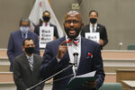 FILE - In this Monday, June 8, 2020, file photo, Assemblyman Mike Gipson, D-Carson, accompanied by other lawmakers and supporters, discusses the measure he is introducing to make it