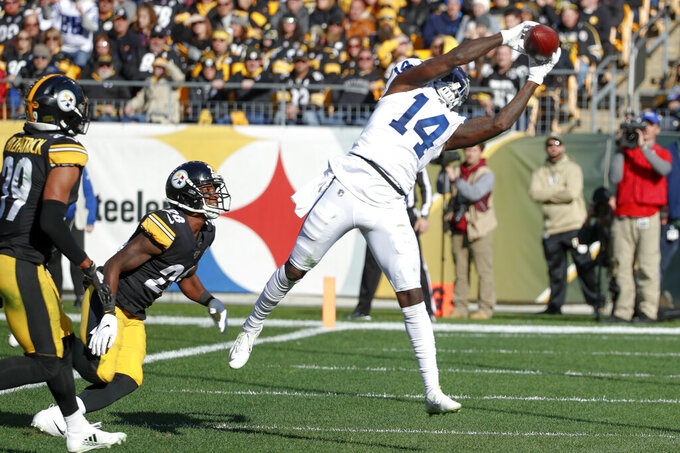 Indianapolis Colts wide receiver Zach Pascal (14) makes a touchdown catch past Pittsburgh Steelers inside linebacker Mark Barron (26) in the first half of an NFL football game, Sunday, Nov. 3, 2019, in Pittsburgh. (AP Photo/Gene J. Puskar)