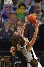 Wake Forest forward Olivia Summiel, right, battles Louisville guard Mykasa Robinson for an offensive rebound in the second quarter of an NCAA women's college basketball game in Winston-Salem, N.C., Sunday, Jan. 24, 2021. (AP Photo/Nell Redmond)