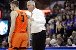 FILE - In this March 6, 2019, file photo, Oregon State coach Wayne Tinkle, right, talks with his son, forward Tres Tinkle, during the first half of the team's NCAA college basketball game against Washington in Seattle. Both Wayne and Tres Tinkle are looking to make their last father-and-son season at Oregon State memorable. Tres Tinkle is a senior this year. He considered leaving for the NBA in the offseason but ultimately decided to return to the Beavers. That means he'll have one more chance to do something with his dad that Oregon State hasn't managed since his first year: Make the NCAA tournament. (AP Photo/Ted S. Warren, File)