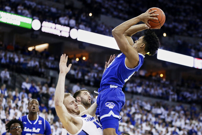 Seton Hall's Jared Rhoden, right, is fouled by Creighton's Kelvin Jones (43) during the first half of an NCAA college basketball game in Omaha, Neb., Saturday, March 7, 2020. (AP Photo/Nati Harnik)