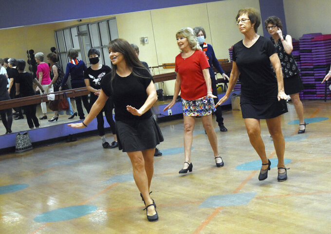 Pam Green, front left, instructor of the tap dance class at the Louisiana Athletic Club in Pineville, La., leads a class including Debbie Morrison, center right, and Shirley Maxey, Friday, Sept. 10, 2021. (Melinda Martinez/The Daily Town Talk via AP)