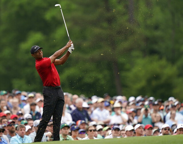 FILE - Tiger Woods hits on the 12th hole during the final round for the Masters golf tournament, Sunday, April 14, 2019, in Augusta, Ga. Woods leaned on experience over shots like this to help him win the Masters for the fifth time. (AP Photo/David J. Phillip)