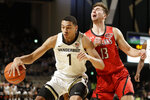 Vanderbilt  forward Dylan Disu (1) drives against Southeast Missouri State forward Isaiah Gable (13) in the first half of an NCAA college basketball game Wednesday, Nov. 6, 2019, in Nashville, Tenn. (AP Photo/Mark Humphrey)