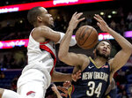 Portland Trail Blazers guard Rodney Hood (5) is fouled by New Orleans Pelicans guard Kenrich Williams (34) in the second half of an NBA basketball game in New Orleans, Friday, March 15, 2019. The Trail Blazers won 122-110. (AP Photo/Scott Threlkeld)
