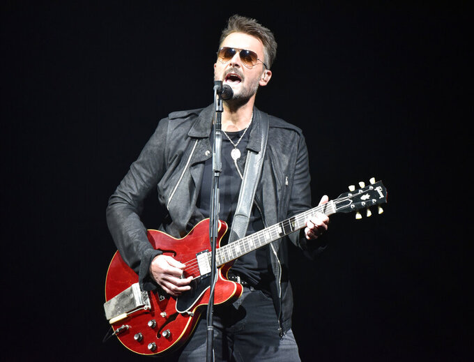 """FILE - In this March 23, 2019 file photo, Eric Church performs during his Double Down tour in Rosemont, Ill. The country singer sent a message to fans in a new video that offers his belief in American resolve to overcome the pandemic. He is teasing new music, including a song called """"Through My Ray Bans"""" from a forthcoming album. (Photo by Rob Grabowski/Invision/AP, File)"""