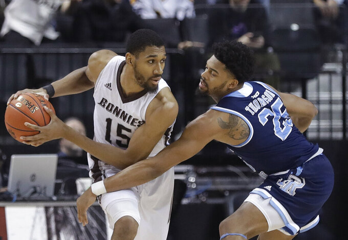 St. Bonaventure's LaDarien Griffin (15) protects the ball from Rhode Island's Christion Thompson (25) during the second half of an NCAA college basketball game in the semifinal round of the Atlantic 10 men's tournament Saturday, March 16, 2019, in New York. St. Bonaventure won 68-51. (AP Photo)