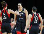 Las Vegas Aces' Liz Cambage, center, celebrates after a play against the Washington Mystics during the second half of Game 4 of a WNBA playoff basketball series Tuesday, Sept. 24, 2019, in Las Vegas. (AP Photo/John Locher)