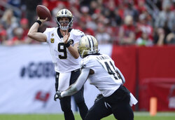 FILE - In this Dec. 9, 2018, file photo, New Orleans Saints quarterback Drew Brees (9) throws a pass to running back Alvin Kamara (41) during the first half of the team's NFL football game against the Tampa Bay Buccaneers in Tampa, Fla. Brees, who turns 40 on Jan. 15, is a leading MVP candidate after breaking his own NFL record for completion percentage, connecting on 74.4 percent of his passes a year after connecting on 72 percent. (AP Photo/Jason Behnken, File)