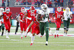 Colorado State running back Marcus McElroy takes off on a long gain against Fresno State during the first half of an NCAA college football game in Fresno, Calif., Saturday, Oct. 26 2019. (AP Photo/Gary Kazanjian)