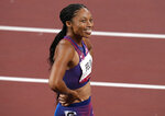 FILE - In this Aug. 6, 2021, file photo, Allyson Felix, of United States smiles after taking the bronze, in the final of women's 400-meters at the 2020 Summer Olympics, in Tokyo, Japan. (AP Photo/Francisco Seco, File)