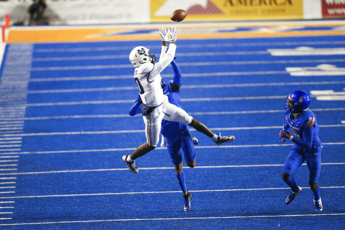 Utah State wide receiver Justin McGriff (10) goes up for the ball late in the second half against Boise State in an NCAA college football game Saturday, Oct. 24, 2020, in Boise, Idaho. Boise State won 42-13. (AP Photo/Steve Conner)
