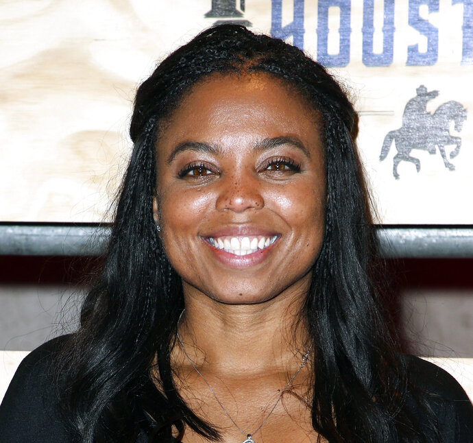 FILE - In this is a Feb. 3, 2017, file photo Jemele Hill attends ESPN: The Party 2017 in Houston, Texas. The outspoken ESPN personality has announced she is leaving the company. Hill attracted attention last year and was briefly suspended for opinionated messages on social media, including a reference to President Donald Trump as a