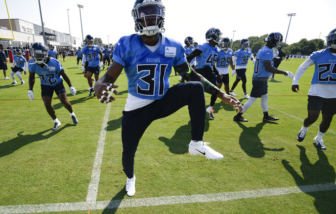 Titans free safety Kevin Byard (31) warms up during an NFL football practice at Saint Thomas Sports Park Saturday, July 27, 2019, in Nashville, Tenn.  (George Walker IV/The Tennessean via AP)