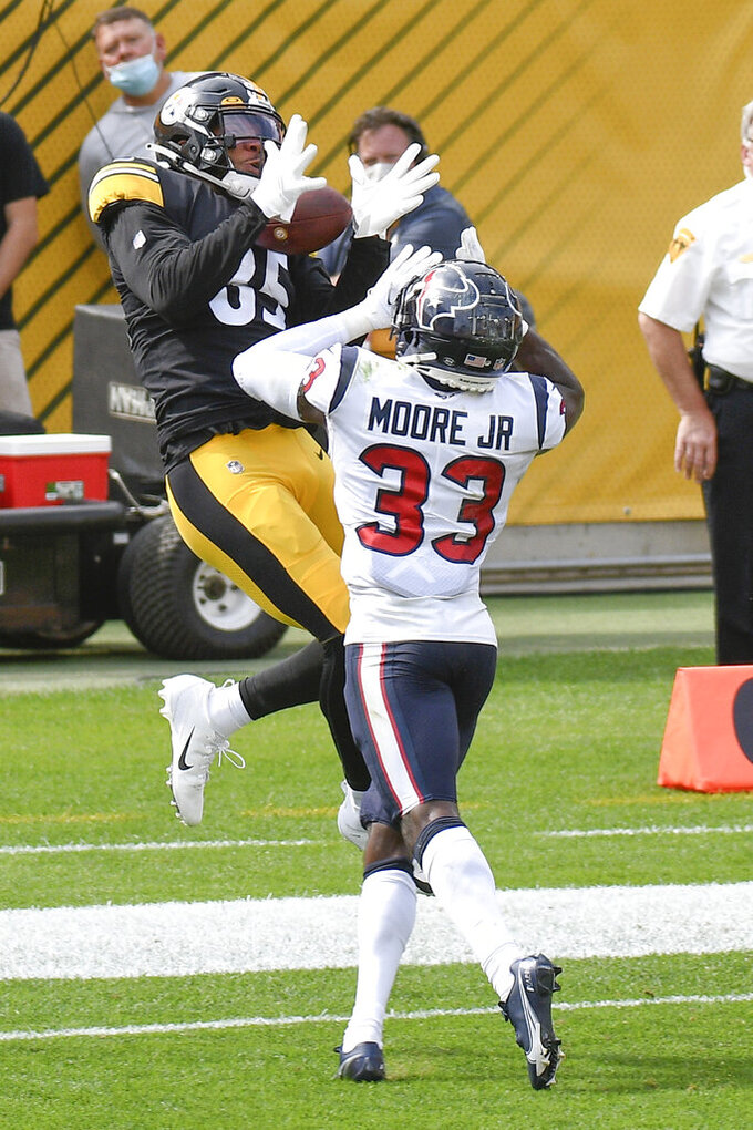 Pittsburgh Steelers tight end Eric Ebron (85) makes a touchdown catch behind Houston Texans safety A.J. Moore (33) in the first half of an NFL football game, Sunday, Sept. 27, 2020, in Pittsburgh. (AP Photo/Don Wright)
