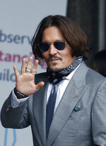 "Actor Johnny Depp arrives at the High Court in London, Thursday, July 16, 2020. Depp is suing News Group Newspapers, publisher of The Sun, and the paper's executive editor, Dan Wootton, over an April 2018 article that called him a ""wife-beater."" The Sun's defense relies on a total of 14 allegations by his ex-wife Amber Heard of Depp's violence. He strongly denies all of them. (AP Photo/Alastair Grant)"