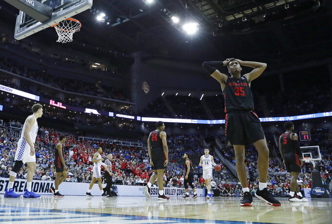 Houston's Fabian White Jr. pauses during the second half of a men's NCAA tournament college basketball Midwest Regional semifinal game against Kentucky, Friday, March 29, 2019, in Kansas City, Mo. (AP Photo/Charlie Riedel)