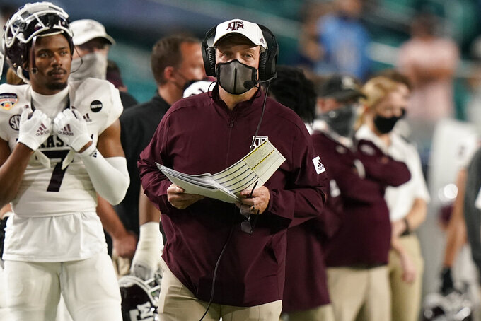 Texas A&M head coach Jimbo Fisher watches his team during the first half of the Orange Bowl NCAA college football game against North Carolina, Saturday, Jan. 2, 2021, in Miami Gardens, Fla. (AP Photo/Lynne Sladky)