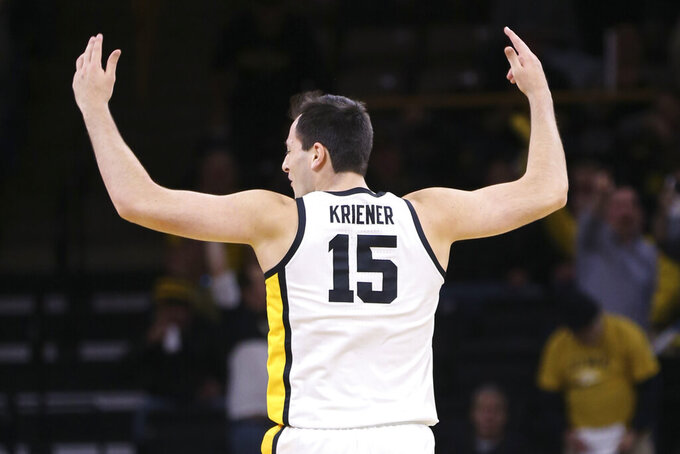 Iowa forward Ryan Kriener (15) celebrates a basket against Michigan during the first half of an NCAA college basketball game Friday, Jan. 17, 2020, in Iowa City, Iowa. (Rebecca F. Miller/The Gazette via AP)
