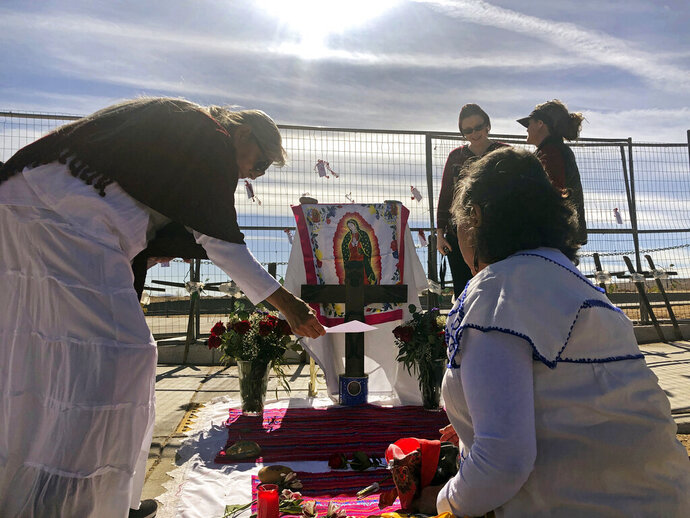 Sylvia Ledesma, left, and Lorrain Cordova prepare for a service to remember the victims and call for more protection for marginalized and vulnerable women in Albuquerque, N.M., on Saturday, Feb. 2, 2019. Ten years ago, police began unearthing the remains of 11 women and an unborn child found buried on Albuquerque's West Mesa, marking the start of a massive homicide investigation that remains open. Known as the West Mesa killings, the victims' deaths have resulted in no arrests, despite the massive homicide investigation police launched after discovering the makeshift graves. (AP Photo/Mary Hudetz)