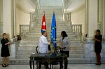 European Union Director-General for International Development, Stefano Manservisi, center left, shakes hands with Ileana Nunez, Cuba's Vice Minister of Foreign Trade and Investment, after signing bilateral agreements in Havana, Cuba, Tuesday, April 16, 2019. Meanwhile the European Union envoy to Cuba, Alberto Navarro, said the EU would defend itself in court if the Trump administration tried to sanction European firms doing business in Cuba. (AP Photo/Ramon Espinosa)