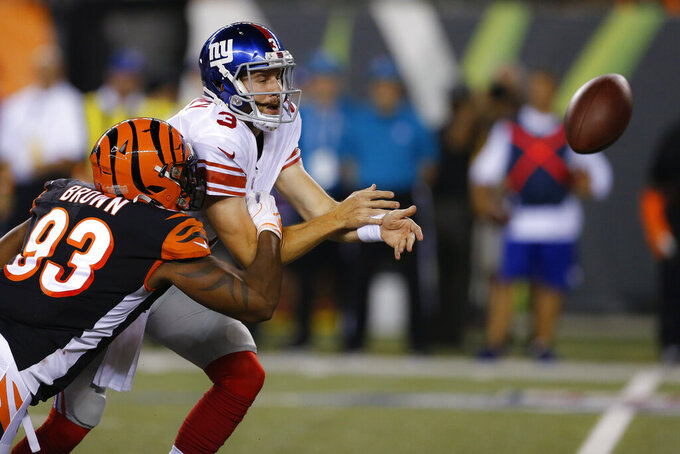 Cincinnati Bengals defensive end Andrew Brown (93) forces a fumble by New York Giants quarterback Alex Tanney (3) during the second half of an NFL preseason football game Thursday, Aug. 22, 2019, in Cincinnati. (AP Photo/Gary Landers)