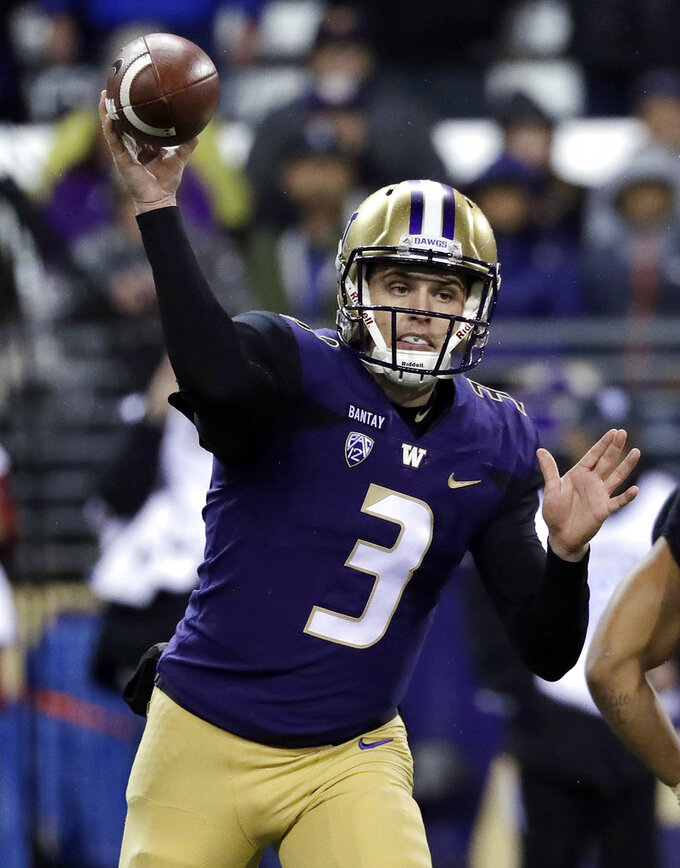 Washington quarterback Jake Browning throws against Stanford during the first half of an NCAA college football game Saturday, Nov. 3, 2018, in Seattle. (AP Photo/Elaine Thompson)