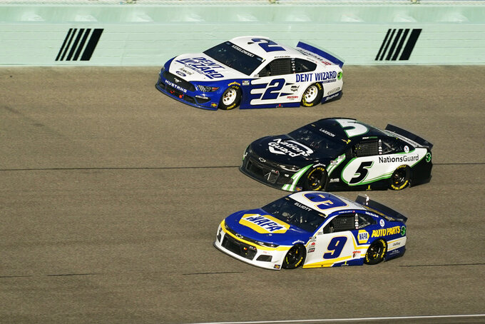 Brad Keselowski (2) Kyle Larson (5) and Chase Elliott (9) battle for position as they round turn four during a NASCAR Cup Series auto race, Sunday, Feb. 28, 2021, in Homestead, Fla. (AP Photo/Wilfredo Lee)