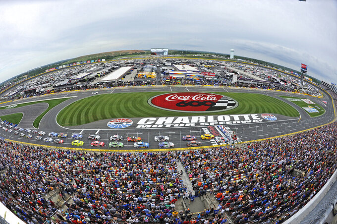 FILE - In this May 27, 2018, file photo, the field takes the green flag to start the NASCAR Cup Series auto race at Charlotte Motor Speedway in Concord, N.C. Some fans have been coming to the Coca-Cola 600 for decades, but they won't be allowed into Charlotte Motor Speedwaý on Sunday, May 24, 2020, due to Covid-19, leaving the grandstands empty and many disappointed. (AP Photo/Mike McCarn, File)