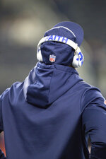 "Dallas Cowboys running back Ezekiel Elliott (21) wears Beats headphones with the words ""Faith"" imprinted on the headband during an NFL game against the Buffalo Bills, Thursday, Nov. 28, 2019 in Dallas. The Bills defeated the Cowboys 26-15. (Margaret Bowles via AP)"