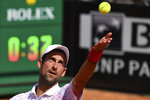 Serbia's Novak Djokovic serves the ball to Italy's Salvatore Caruso, at the Italian Open tennis tournament in Rome, Wednesday, Sept. 16, 2020. (Alfredo Falcone/LaPresse via AP)
