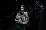A model wears a creation as part of Emporio Armani's Fall/Winter 2020/2021 collection, presented in Milan, Italy, Friday Feb. 21, 2020. (AP Photo/Antonio Calanni)