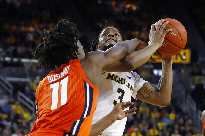 Michigan guard Zavier Simpson (3) is fouled by Illinois guard Ayo Dosunmu (11) during the second half of an NCAA college basketball game, Saturday, Jan. 25, 2020, in Ann Arbor, Mich. (AP Photo/Carlos Osorio)