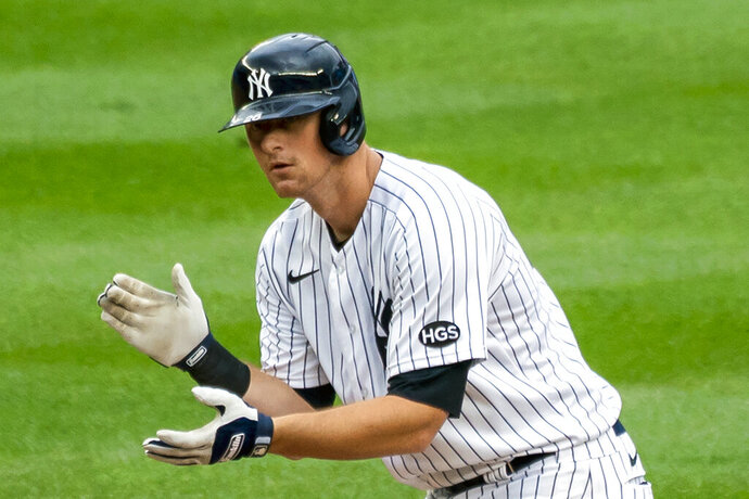 FILE - New York Yankees' DJ LeMahieu celebrates at second base after hitting a two-run double during the sixth inning of a baseball game against the Miami Marlins at Yankee Stadium in New York, in this Saturday, Sept. 26, 2020, file photo. The New York Yankees and AL batting champion DJ LeMahieu worked Friday, Jan. 15, 2021, to put in place a six-year contract worth about $90 million, a person familiar with the deal told The Associated Press. The person spoke on condition of anonymity because the agreement is subject to a successful physical. (AP Photo/Corey Sipkin, File)