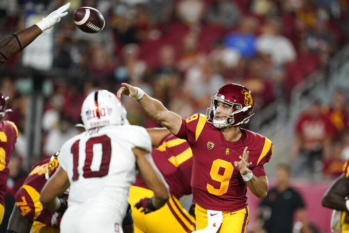 Southern California quarterback Kedon Slovis (9) throws a pass during the first half of the team's NCAA college football game against Stanford on Saturday, Sept. 11, 2021, in Los Angeles. (AP Photo/Marcio Jose Sanchez)