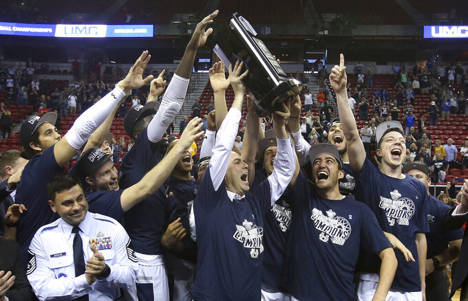 Utah State celebrates after defeating San Diego State following an NCAA college basketball game in the Mountain West Conference men's tournament championship Saturday, March 16, 2019, in Las Vegas. (AP Photo/Isaac Brekken)