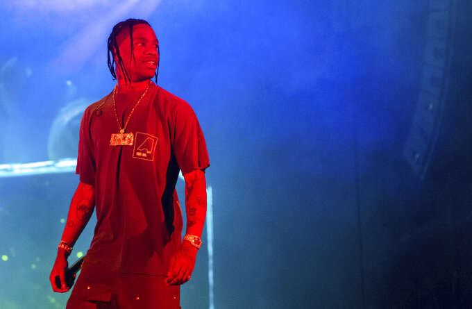 """FILE - In this Sept. 15, 2019 file photo, Travis Scott performs during Day 2 of Music Midtown in Atlanta. In April 2021, Scott was honored for his work as one of five recipients of the inaugural RAD impact awards. Scott plans to give """"several"""" scholarships to HBCU students with the funds. (Photo by Paul R. Giunta/Invision/AP, File)"""