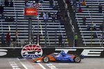 Scott Dixon crosses the finish line to win the IndyCar Series auto race at Texas Motor Speedway on Saturday, May 1, 2021, in Fort Worth, Texas. (AP Photo/Richard W. Rodriguez)