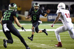 North Texas quarterback Mason Fine (6) carries the ball during the first half of an NCAA college football game against Florida Atlantic, Thursday, Nov. 15, 2018 in Denton, Texas. (Jake King/The Denton Record-Chronicle via AP)