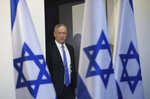 FILE - In this Nov. 20, 2019, file photo, Blue and White party leader Benny Gantz arrives to address media in Tel Aviv, Israel. President Donald Trump is holding back-to-back meetings with Israeli Prime Minister Benjamin Netanyahu and his chief challenger ahead of the unveiling of the U.S. administration's much-anticipated plan to resolve the Israeli-Palestinian conflict. The meetings come just a month before Netanyahu and Benny Gantz are set to face off in national elections for the third time in less than a year. (AP Photo/Oded Balilty, File)