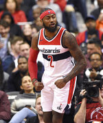Washington Wizards guard John Wall (2) reacts during the first half of an NBA basketball game against the Miami Heat, Thursday, Oct. 18, 2018, in Washington. (AP Photo/Nick Wass)